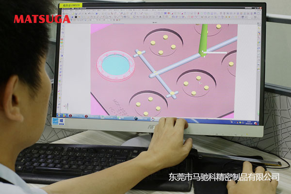 游戏币定制包胶加工模具设计